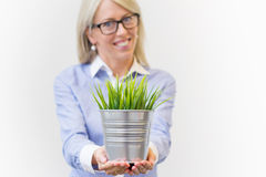 Young woman holding pot with decorative start-up Stock Photo
