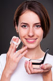 Young woman holding powder Royalty Free Stock Photos