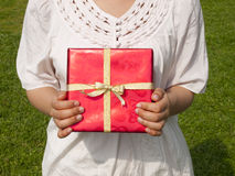 Young woman holding present. Midsection of a young woman holding present Stock Photography