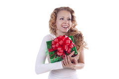 Young woman holding present Royalty Free Stock Photos