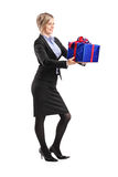Young woman holding a present Royalty Free Stock Images