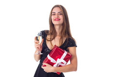 Young woman holding a present and a glass of champagne Royalty Free Stock Photos