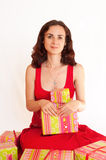 Young woman holding a present Royalty Free Stock Photos