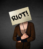 Young woman holding a protest sign Stock Photography