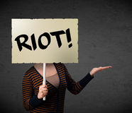 Young woman holding a protest sign Royalty Free Stock Images