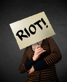 Young woman holding a protest sign Stock Photo