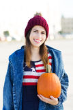 Young woman holding a pumpkin Stock Image