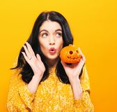 Young woman holding a pumpkin Royalty Free Stock Photography