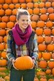 Young woman holding pumpkin Stock Photos