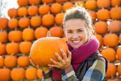 Young woman holding pumpkin Royalty Free Stock Photo
