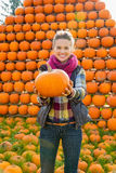 Young woman holding pumpkin Royalty Free Stock Photography