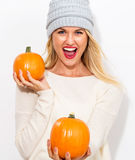 Young woman holding pumpkins Royalty Free Stock Images