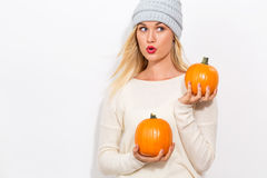 Young woman holding pumpkins Royalty Free Stock Photography