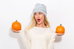 Young woman holding pumpkins Stock Image