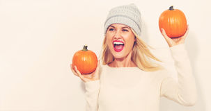 Young woman holding pumpkins Royalty Free Stock Photo