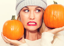 Young woman holding pumpkins Royalty Free Stock Photos