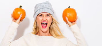 Young woman holding pumpkins Stock Images