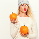 Young woman holding pumpkins Stock Photography