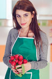 Young woman holding radishes royalty free stock photo