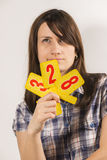 Young woman holding ratings. Young woman holding different figure of numbers royalty free stock images