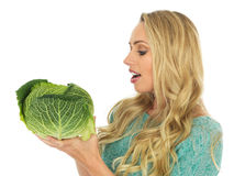 Young Woman Holding a Raw Uncooked Cabbage Royalty Free Stock Image