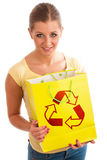 Young woman holding recycle paper bag. Stock Photo