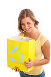 Young woman holding recycle paper bag. Royalty Free Stock Images