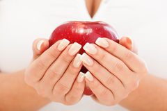 Young woman holding red apple Royalty Free Stock Photography