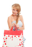 Young woman holding red bags for shopping Stock Photo