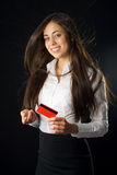 Young woman holding red credit card Royalty Free Stock Images