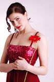 Young woman holding a red flower. Girl with a red herbera Stock Photos