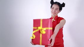 Woman holding red gift box in concept of happy chinese new year stock footage