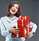 Young woman holding red gift box. Stock Photos