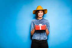 Young woman holding red gift in hands Royalty Free Stock Photos