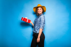 Young woman holding red gift in hands Stock Photography
