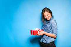 Young woman holding red gift in hands Royalty Free Stock Image