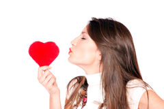 Young woman holding a red heart Stock Images