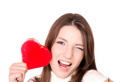Young woman holding a red heart Stock Photography