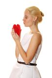 Young woman holding red heart Stock Images