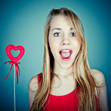 Young woman holding red heart Royalty Free Stock Image