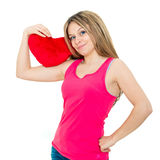 Young woman holding a red heart Royalty Free Stock Image