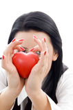 Young woman holding a red heart Royalty Free Stock Photography