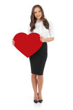 Young woman holding red heart banner. White background Royalty Free Stock Photography