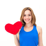 Young woman holding a red heart Stock Image