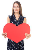 Young woman holding red heart Stock Image