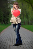 Young woman holding red heart shaped balloon Royalty Free Stock Images