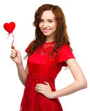 Young woman holding red heart Stock Photography