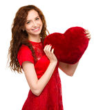 Young woman holding red heart Royalty Free Stock Images