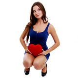 Young woman holding red heart Stock Photo