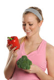 Young Woman holding a red pepper and broccoli Royalty Free Stock Photo